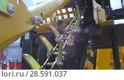 Купить «Trencher machine, a moving chain with many incisors», видеоролик № 28591037, снято 10 июня 2018 г. (c) Андрей Радченко / Фотобанк Лори