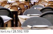 Купить «Tables with plates and cutlery in a street restaurant», видеоролик № 28592109, снято 15 января 2018 г. (c) BestPhotoStudio / Фотобанк Лори