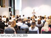 Купить «Business speaker giving a talk at business conference event.», фото № 28592389, снято 15 июня 2018 г. (c) Matej Kastelic / Фотобанк Лори