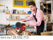Купить «Joiner working on machine», фото № 28592713, снято 8 апреля 2017 г. (c) Яков Филимонов / Фотобанк Лори