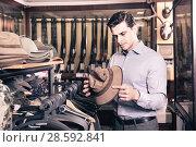Купить «Portrait of man choosing hunting outfit in shop», фото № 28592841, снято 11 декабря 2017 г. (c) Яков Филимонов / Фотобанк Лори