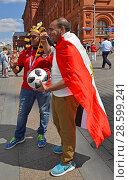 2018 FIFA World Cup. Fans with soccer ball with autographs from Egypt in center of Moscow. Редакционное фото, фотограф Валерия Попова / Фотобанк Лори