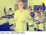 Купить «manicurist showing her workplace», фото № 28599925, снято 2 ноября 2016 г. (c) Яков Филимонов / Фотобанк Лори