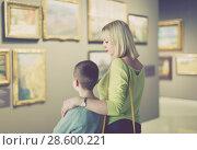 Купить «Laughing mother and son exploring paintings», фото № 28600221, снято 18 марта 2017 г. (c) Яков Филимонов / Фотобанк Лори