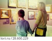 Купить «Mother and son looking at paintings in halls of museum», фото № 28600229, снято 18 марта 2017 г. (c) Яков Филимонов / Фотобанк Лори