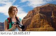 Купить «woman with backpack and camera at grand canyon», фото № 28605617, снято 25 июля 2015 г. (c) Syda Productions / Фотобанк Лори