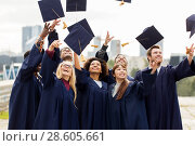 Купить «happy graduates or students throwing mortar boards», фото № 28605661, снято 24 сентября 2016 г. (c) Syda Productions / Фотобанк Лори