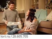Купить «happy couple with food on tray at home», фото № 28605705, снято 13 января 2018 г. (c) Syda Productions / Фотобанк Лори