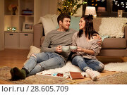 Купить «happy couple drinking cacao at home», фото № 28605709, снято 13 января 2018 г. (c) Syda Productions / Фотобанк Лори