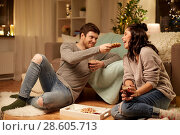 Купить «happy couple eating waffles with cacao at home», фото № 28605713, снято 13 января 2018 г. (c) Syda Productions / Фотобанк Лори