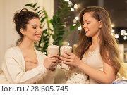 Купить «happy female friends drinking cacao at home», фото № 28605745, снято 21 января 2018 г. (c) Syda Productions / Фотобанк Лори