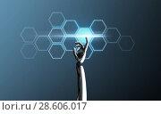 Купить «robot hand touching network cells», фото № 28606017, снято 25 мая 2020 г. (c) Syda Productions / Фотобанк Лори