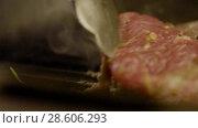 Купить «Cook Frying Piece Of Freshly Smelled Steak», видеоролик № 28606293, снято 29 мая 2018 г. (c) Pavel Biryukov / Фотобанк Лори