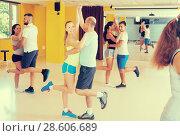 Купить «Positive adults dancing salsa together in studio», фото № 28606689, снято 21 июня 2017 г. (c) Яков Филимонов / Фотобанк Лори