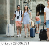Купить «Happy couple tourists taking walk on summer day», фото № 28606781, снято 22 июня 2017 г. (c) Яков Филимонов / Фотобанк Лори