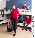 Купить «Female traveler leaving hostel», фото № 28606917, снято 22 марта 2018 г. (c) Яков Филимонов / Фотобанк Лори