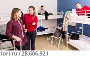 Купить «Girl meeting female neighbor in hostel», фото № 28606921, снято 22 марта 2018 г. (c) Яков Филимонов / Фотобанк Лори