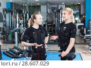 Купить «women in EMS vests talking», фото № 28607029, снято 16 апреля 2018 г. (c) Яков Филимонов / Фотобанк Лори