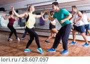 Купить «People learning swing at dance class», фото № 28607097, снято 24 октября 2018 г. (c) Яков Филимонов / Фотобанк Лори