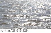 Купить «Расфокусированные речные волны, многочисленные блики от солнца на их поверхности», видеоролик № 28615129, снято 20 июня 2018 г. (c) Круглов Олег / Фотобанк Лори