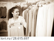 Купить «Woman buying new skirt at the store», фото № 28615697, снято 20 октября 2018 г. (c) Яков Филимонов / Фотобанк Лори