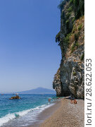 Купить «The beach on Amalfi Coast,  the volcano Mount Vesuvius in the background. Vico Equense. Italy», фото № 28622053, снято 22 июля 2017 г. (c) Николай Коржов / Фотобанк Лори