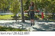 Купить «Young slender woman jumping with a rope, boxing workout outdoors at sunny day», видеоролик № 28622881, снято 18 марта 2019 г. (c) Константин Шишкин / Фотобанк Лори
