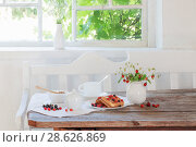 Купить «breakfast with berries on old wooden table», фото № 28626869, снято 20 июня 2018 г. (c) Майя Крученкова / Фотобанк Лори