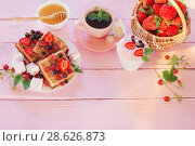 Купить «breakfast with strawberries on pink wooden table», фото № 28626873, снято 20 июня 2018 г. (c) Майя Крученкова / Фотобанк Лори
