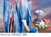 Купить «Wolf Zabivaka and Welcome flags in honour of the 2018 FIFA World Cup in Russia», фото № 28627381, снято 15 июня 2018 г. (c) Владимир Журавлев / Фотобанк Лори
