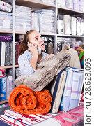 Купить «Young woman customer buying multiple items», фото № 28628093, снято 24 сентября 2018 г. (c) Яков Филимонов / Фотобанк Лори
