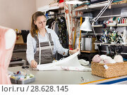 Woman professional working with material at sewing workshop. Стоковое фото, фотограф Яков Филимонов / Фотобанк Лори