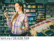 Купить «woman customer holding glass jar with color paint in art department», фото № 28628169, снято 12 апреля 2017 г. (c) Яков Филимонов / Фотобанк Лори