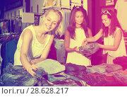 Купить «Girls choosing denim trousers together», фото № 28628217, снято 19 января 2019 г. (c) Яков Филимонов / Фотобанк Лори