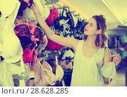 Купить «Woman buying brassiere», фото № 28628285, снято 19 июня 2017 г. (c) Яков Филимонов / Фотобанк Лори