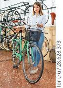 Купить «Portrait woman who is satisfied of shopping and standing with bicylce», фото № 28628373, снято 14 мая 2018 г. (c) Яков Филимонов / Фотобанк Лори
