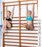 Купить «Two females during workout», фото № 28628413, снято 10 мая 2018 г. (c) Яков Филимонов / Фотобанк Лори