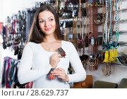 Купить «Positive girl choosing fashion brooch in store», фото № 28629737, снято 17 января 2018 г. (c) Яков Филимонов / Фотобанк Лори