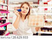 Купить «Woman choosing face powder at shopwoman, girl, customer, cosmetic, shop, store, boutique, test, applying, powder, foundation, brush, decorative, makeup, face, beauty, accessories, femininity, stylish, visage, choosing, shopping, market, sale, offer, choice, assortment, sample, shelves, new, quality, brand, price, emotion, concentrated, positive, indoors, portrait, young, adult, female, person, one, 20s, spanish, hobby, leisure, lifestyle,», фото № 28629933, снято 31 января 2018 г. (c) Яков Филимонов / Фотобанк Лори
