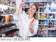 Купить «Cheerful young woman looking for new mascara», фото № 28629945, снято 31 января 2018 г. (c) Яков Филимонов / Фотобанк Лори