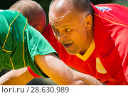 Купить «KAZAN, RUSSIA - JUNE 23, 2018: Traditional Tatar festival Sabantuy - Adult men in the struggle of national wrestling kuresh under the sun», фото № 28630989, снято 23 июня 2018 г. (c) Константин Шишкин / Фотобанк Лори