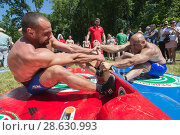 Купить «KAZAN, RUSSIA - JUNE 23, 2018: Traditional Tatar festival Sabantuy - Strong men wrestling outdoors at summer day», фото № 28630993, снято 23 июня 2018 г. (c) Константин Шишкин / Фотобанк Лори
