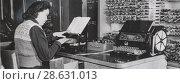 Купить «Сотрудник Института точной механики и вычислительной техники вводит данные в БЭСМ. 22.07.1955», фото № 28631013, снято 21 июля 2018 г. (c) Retro / Фотобанк Лори
