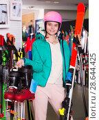 Купить «Adult girl in skiing outfit», фото № 28644425, снято 6 февраля 2018 г. (c) Яков Филимонов / Фотобанк Лори