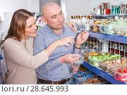 Купить «couple selecting variety candies», фото № 28645993, снято 11 апреля 2018 г. (c) Яков Филимонов / Фотобанк Лори
