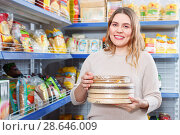 Купить «Adult positive woman buyer with cake layers of grocery food store», фото № 28646009, снято 11 апреля 2018 г. (c) Яков Филимонов / Фотобанк Лори
