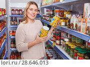 Купить «Female in shop holding pickle goods in grocery section», фото № 28646013, снято 11 апреля 2018 г. (c) Яков Филимонов / Фотобанк Лори