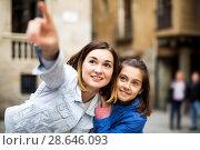 Купить «Mother and daughter pointing at sight during», фото № 28646093, снято 18 июля 2018 г. (c) Яков Филимонов / Фотобанк Лори