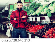 Купить «Male seller standing near the shelves in grocery shop», фото № 28646213, снято 15 ноября 2016 г. (c) Яков Филимонов / Фотобанк Лори
