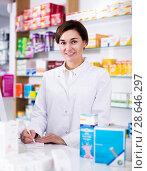 Купить «Pharmacist ready to assist in choosing at counter», фото № 28646297, снято 31 января 2017 г. (c) Яков Филимонов / Фотобанк Лори